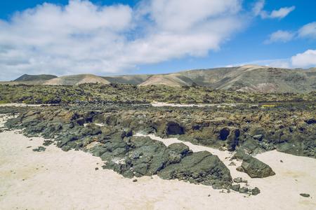 Lanzerote summer sun and beach with vulcano rocks.