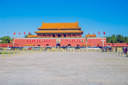 Tiananmen square, Pekin, China, Peoples and buildings at square.  Red flags an urban city view. 2016 autumn.