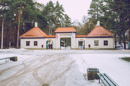 Riga, Latvia, Zoo entrance an peoples. Old building and snow , winter. Stock Photo
