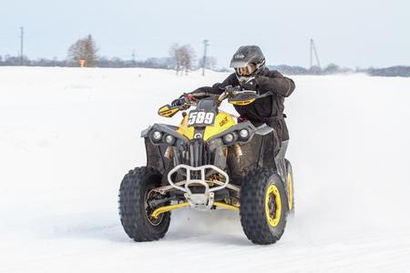 Latvia, Jaunrauna, Winter motocross, Driver with quadracycle, race. 2013