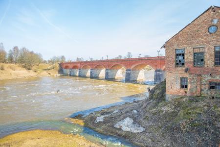 City Kuldiga, bridge and river at Latvia. Peoples walk around.
