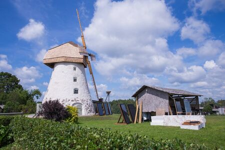City Araisi, Latvia. Old windmills and nature, green grass and blue sky. Travel photo 2018