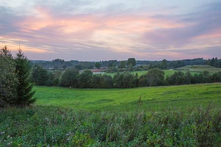 City of Kraslava, Latvia. Early morning with sunlight, meadow and trees. Nature photo. Stock Photo