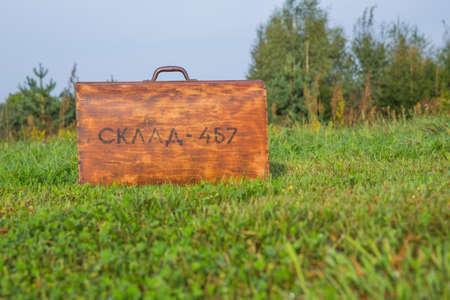City Kraslava, Latvia. Old woden retro suitcase and nature.