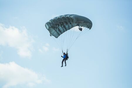 City Riga, Latvian republic. Avio show in honor of the city festival. Parachutists land with parachutes on target. 17 August 2019.
