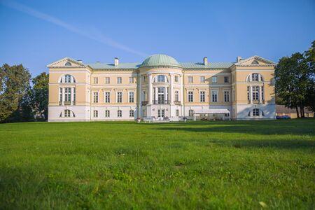 City Mezotne, Latvia Republic. Park with old castle. Trees and green zone. Sep 9. 2019 Travel photo. Publikacyjne