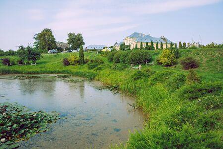City Brukna, Latvia Republic. Park with old manor. Trees and green zone. Sep 9. 2019 Travel photo. Reklamní fotografie