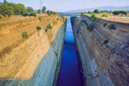 Corinth Canal, Greek Republic. Canal, rocks and sun. Urban city. 14. Sep. 2019