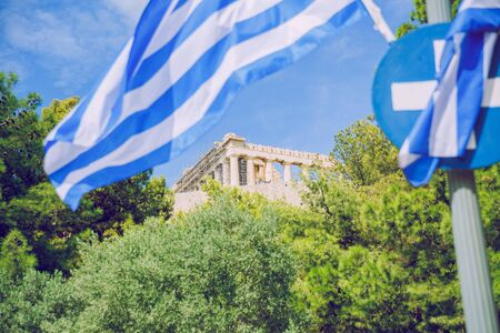 City Athens, Greece Republic. Greek flag and Acropolis. Sep 11 2019. Travel photo.