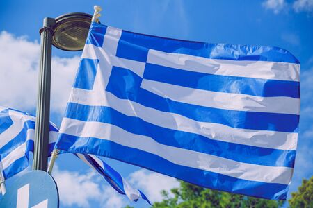 City Athens, Greece Republic. Greek flag and wind. Sep 11 2019. Travel photo.