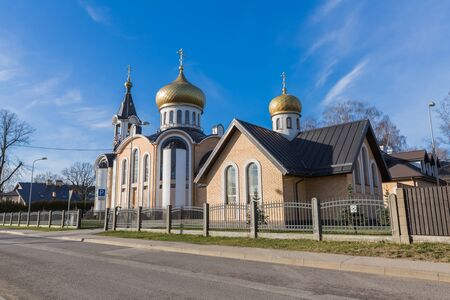 City, Riga, Latvia. Orthodox church with domes and bell. Travel photo. 04.02.2020