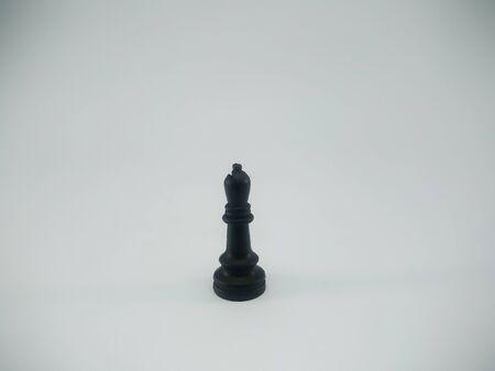 Black plastic bishop chess piece isolated on a white background Standard-Bild