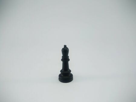 Black plastic bishop chess piece isolated on a white background Imagens