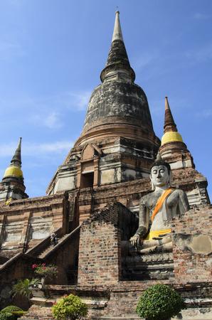 Pagoda and Buddha statue at Wai Yai Chai Mongkol in Ayutthaya, Thailand photo