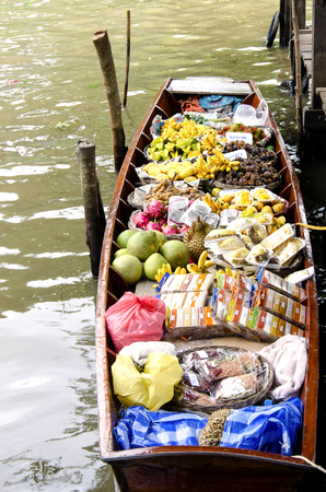 The canoe filled with fresh fruits at the Floating Market   Damnoen Saduak   In Thailand photo