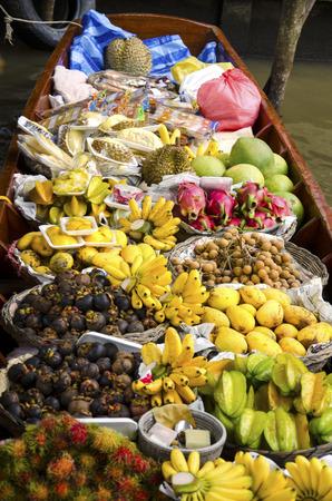 The canoe filled with fresh fruits at the Floating Market   Damnoen Saduak   In Thailand photo