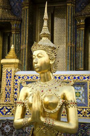 The Statue of Kinnara at Grand Palace in Bangkok, Thailand photo