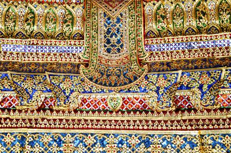 phra si rattana chedi: The close-up view of the mosaic decoration at Grand Palace in Bangkok, Thailand