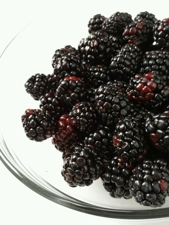 Fresh blackberries on a plate Banco de Imagens