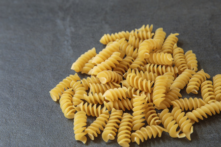 rotini: rotini on a slate background