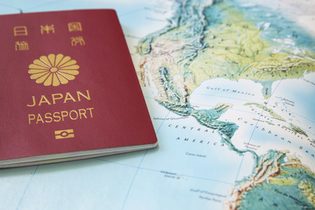 Japanese Passport on the world map Stock Photo