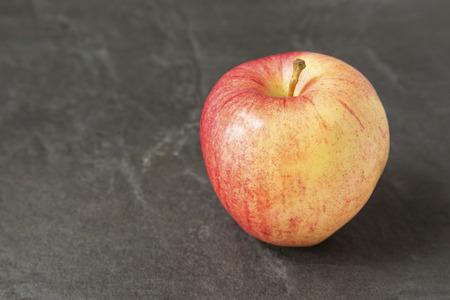 Fuji apple on slate background