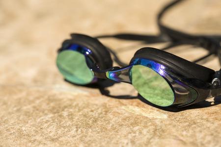 swim goggles: Swim goggles on the tile background Foto de archivo