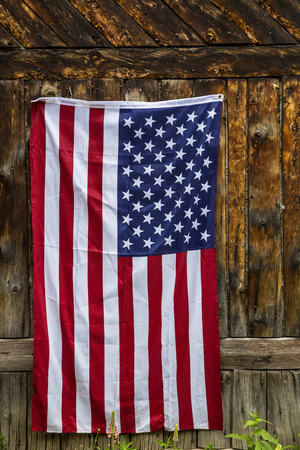 American flag on rustic wood background