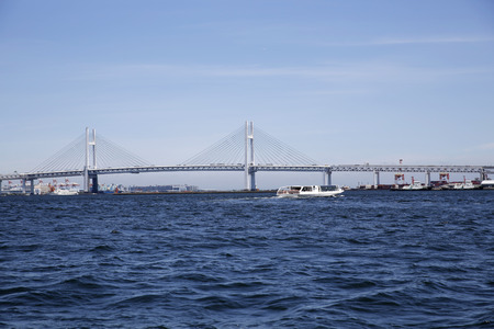 bay bridge: The Yokohama Bay Bridge with a water taxi in Yokohama, Japan