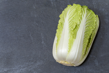 Napa cabbage on slate background