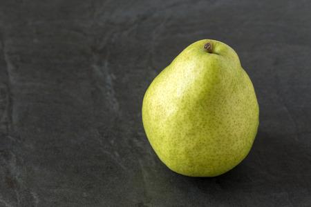 Single Anjou pear on the slate background