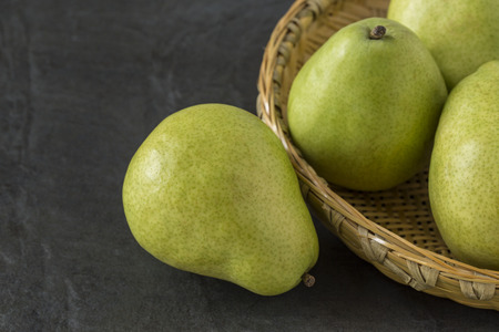 anjou: Anjou Pears with a bamboo tray on the slate background