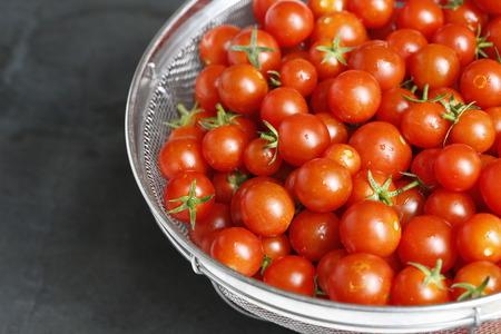 Fresh Cherry Tomato in the silver colander