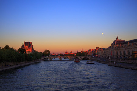 Moonrise over Seine River in Paris, France