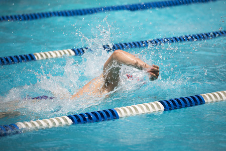 Young male swimmer during a swim meet