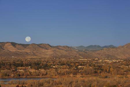 Full moon over Rocky Mountains Stock Photo