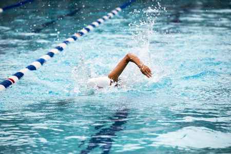 Teen female swimmer at a swim meet Stock Photo - 105233099