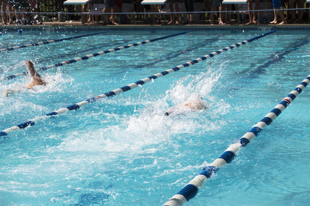 Two male swimmers at a swim meet