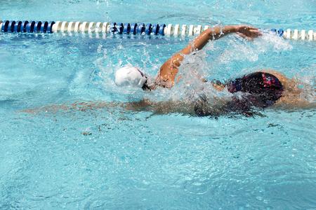 Teen female swimmer at a swim meet