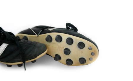 soccer cleats: SoccerFootball cleats with a white background Stock Photo