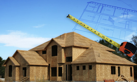 lend: A home under construction with house plans outlines hovering in the sky and a measuring tape