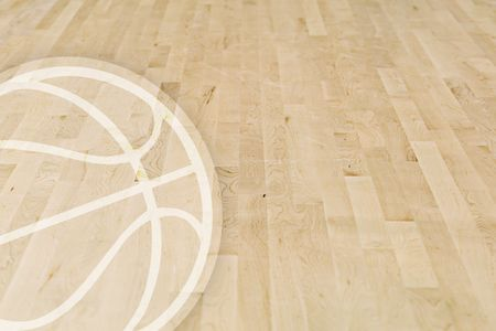 A wooden basketball floor with a basketball logo in the left corner Stock Photo