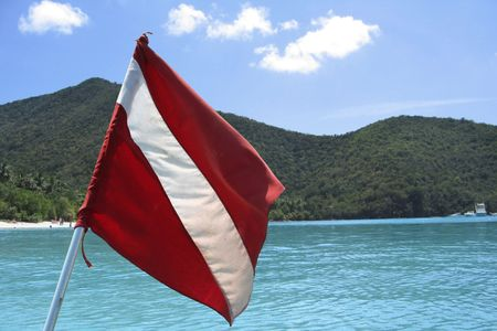 Scuba Diving Flag with a Caribbean Island in the background