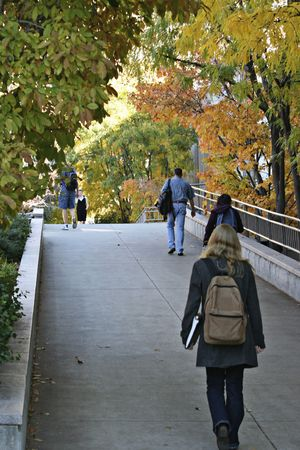 Fall colors on campus with students walking Stock Photo