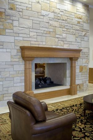 floorboards: An elegant mantle in a rock wall setting in an expensive home