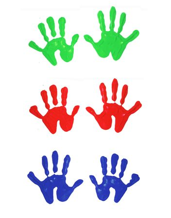 Multi-colored finger painted hand prints of children Stock Photo