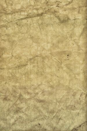 A tattered old grungy paper with worn texture photo