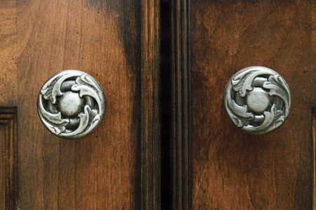 A close-up view of cabinets and elegant cabinet hardware handles Stock Photo