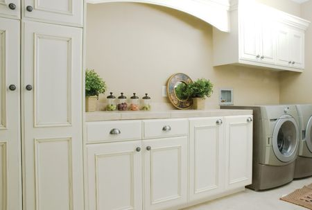 Elegant White Cabinets in a Laundry Room