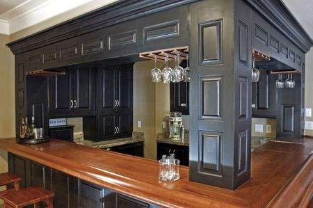 custom built: Custom-built bar and wood cabinetry